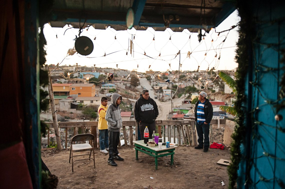 Editorial photography of guys standing in yard in Tijuana Mexico