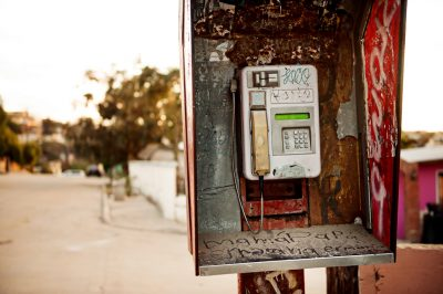 Editorial photography of old pay phone in Tijuana Mexico