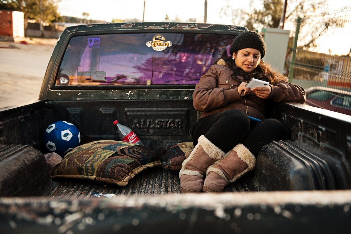 Editorial photography of woman in pickup bed in Tijuana Mexico