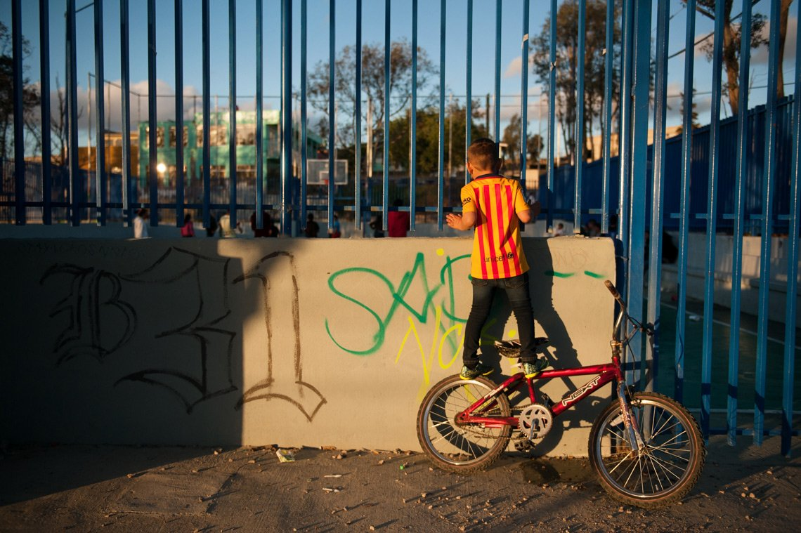 Editorial photography of boy watching soccer in Tijuana Mexico