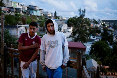 An environmental portrait of two teen boys in Tijuana, Mexico.