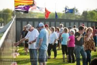Crowds of people look at the wall of the traveling Vietnam Veterans Memorial in Albert lea MN