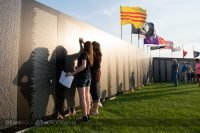 Two women look for name son the traveling Vietnam Veterans Memorial in Albert lea Minnesota