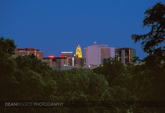The Rochester Minnesota skyline against a deep blue sky.