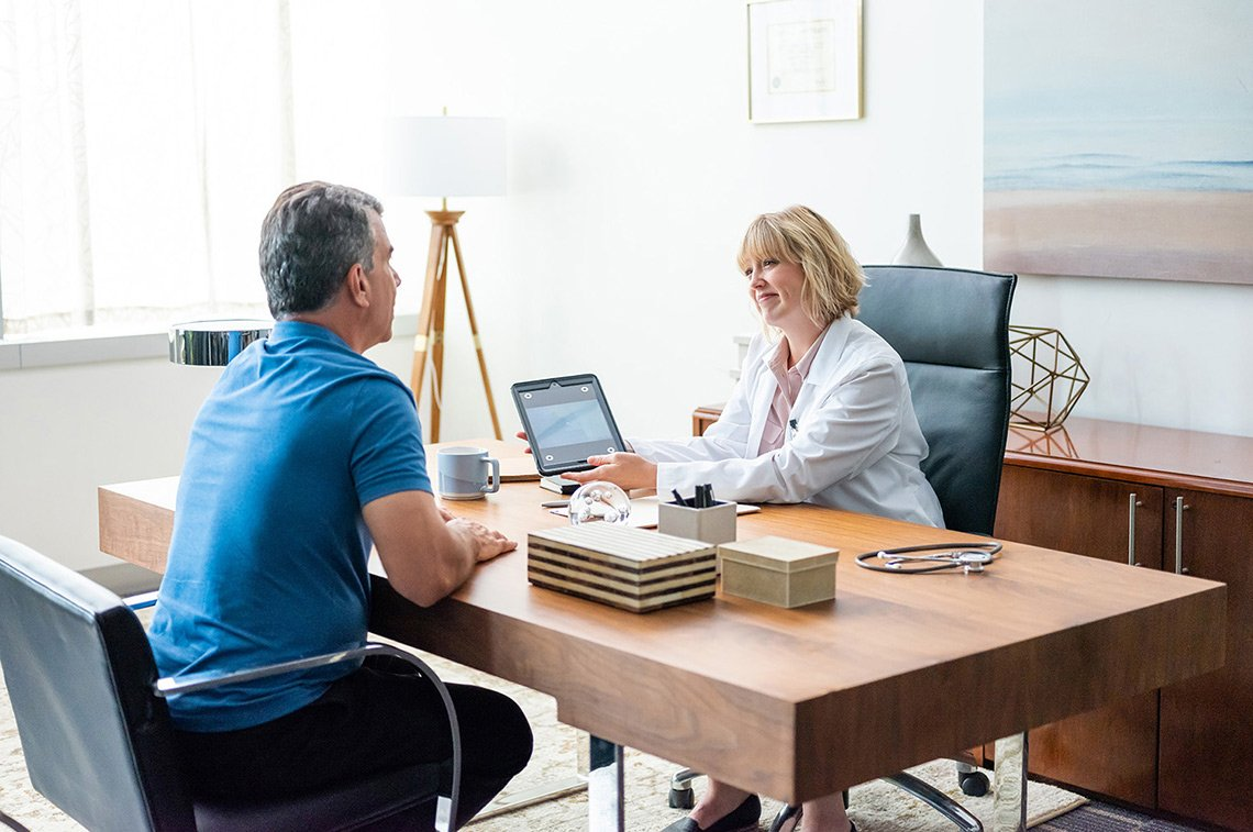A doctor and patient in an office setting for Fujifilm Healthcare