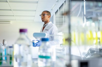 Advertising portrait of Fujifilm healthcare worker in a lab setting