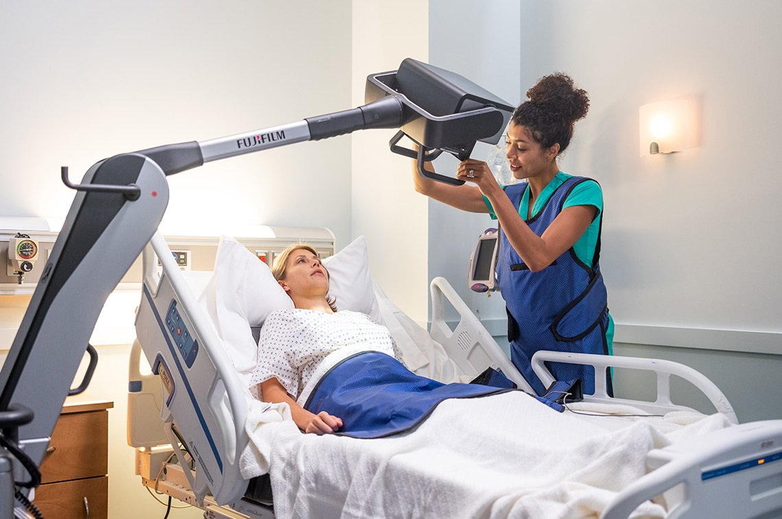 Healthcare photography of a medical tech and a patient