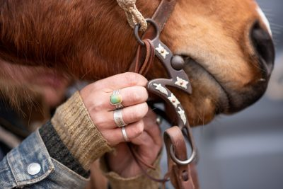 Editorial photography of Colorado cowgirl hands on horse reigns