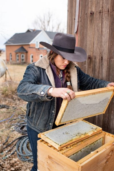Editorial photography of cowgirl working with bees in Colorado