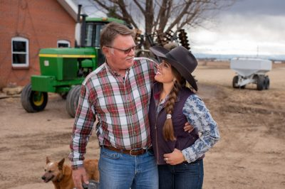Editorial photography of cowgirl hugging father in Colorado