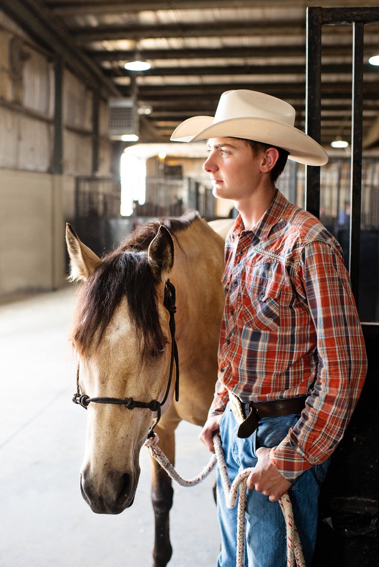A portrait of a young cowboy with his horse at the fair in Rochester MN