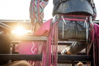 Editorial photo of cowboy sitting on gate at Rochester Mn rodeo