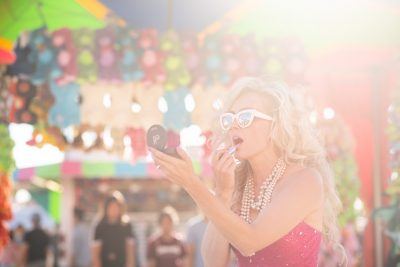Editorial fashion photo of a model in pink dress at Rochester mn fair