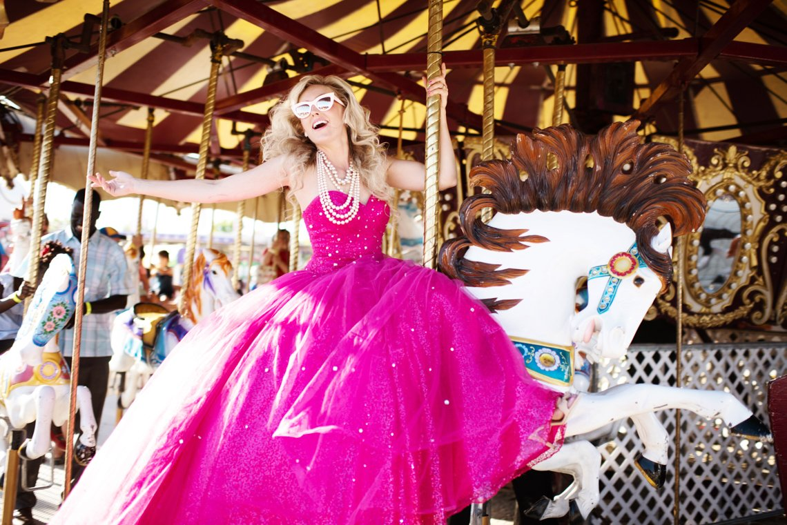 Commercial fashion photo of a model in pink dress at Rochester mn fair