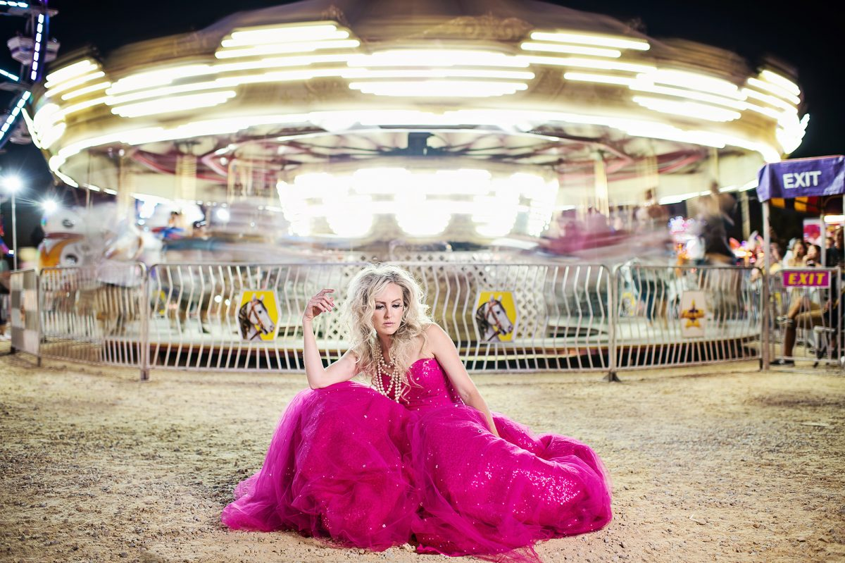 Fashion photo of model in pink dress at Rochester Minnesota fair