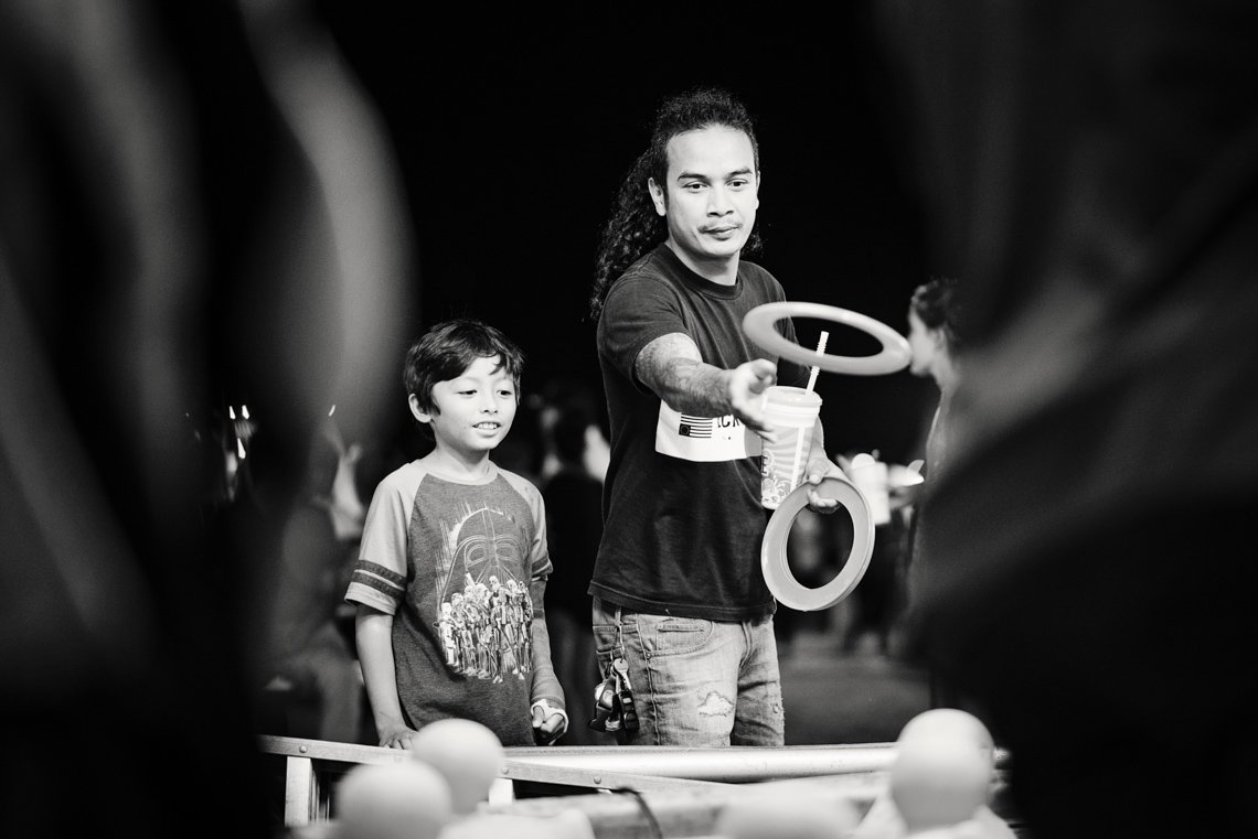 Editorial photo of father and son playing games at Rochester Mn fair