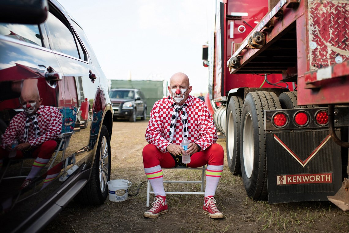 Rodeo clown sitting on chair before rochester mn event - editorial photo