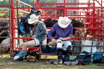 Cowboys getting ready at rochester mn rodeo - editorial photo