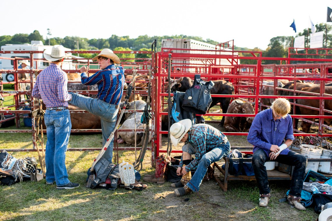 Bullriders getting ready at Rochester mn rodeo - editorial photo