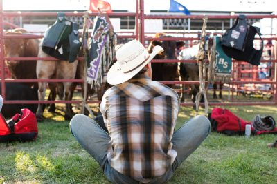 Bullrider stretching at Rochester mn rodeo - editorial photo