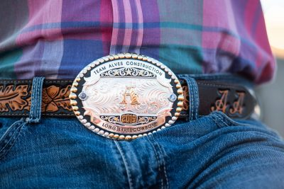Bullrider's belt buckle at Rochester mn rodeo - editorial photo