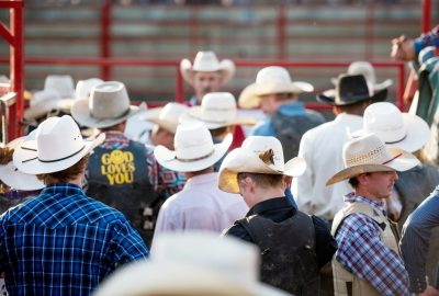 Editorial photo of a group of cowboys wearing hats at the rochester mn rodeo