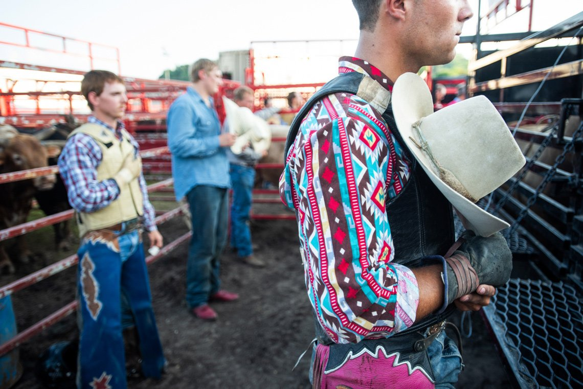 Editorial photo of bull rider's during national anthem at the rochester mn rodeo