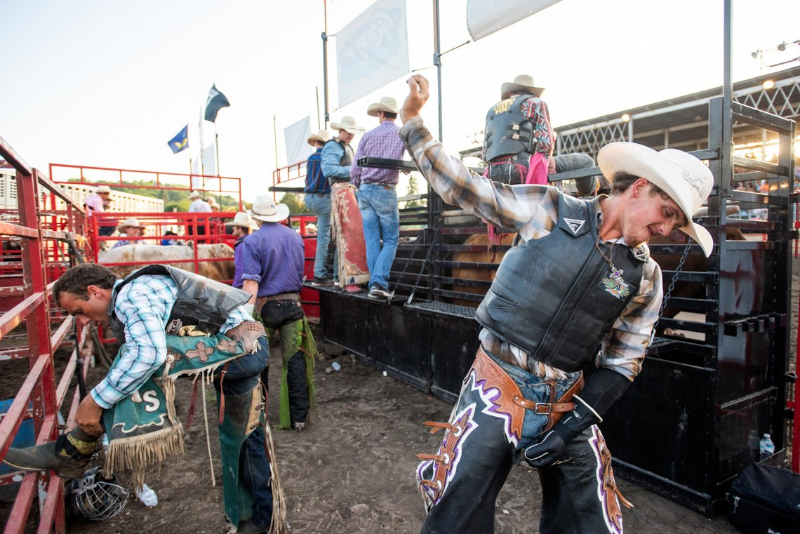 Editorial photography of a few bull riders preparing at rochester mn rodeo
