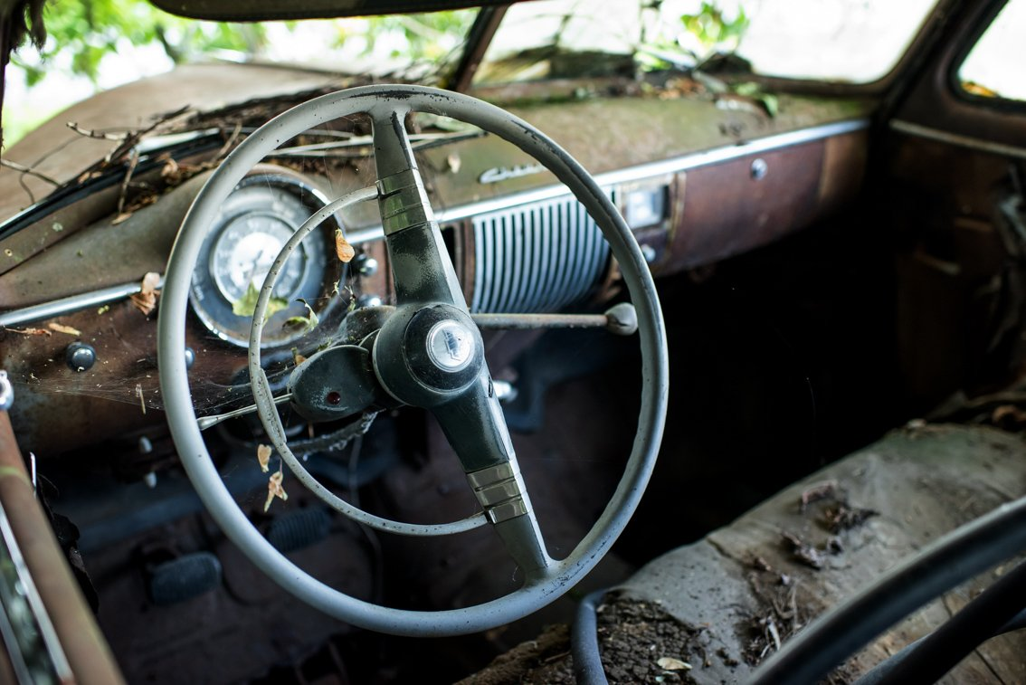 steering wheel of old Chevy Deluxe