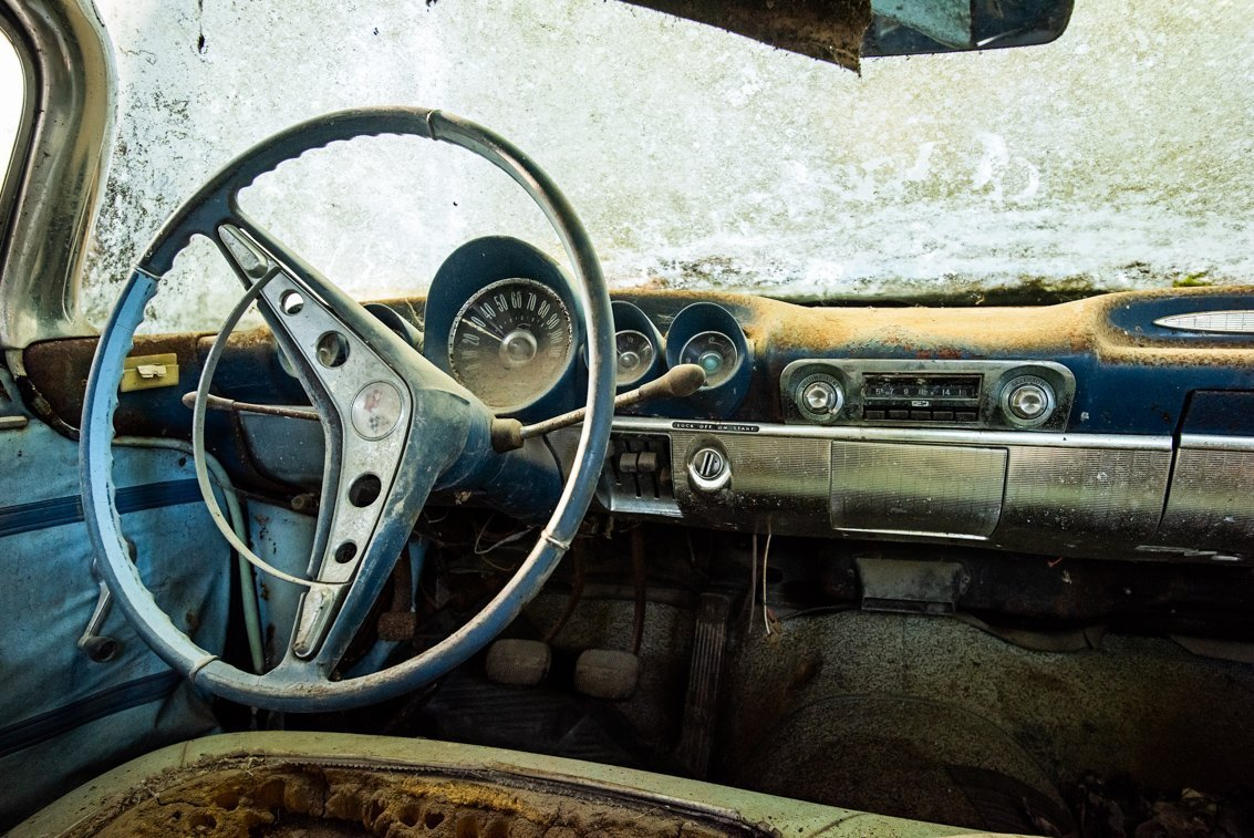 dashboard of rusted Chevrolet Impala