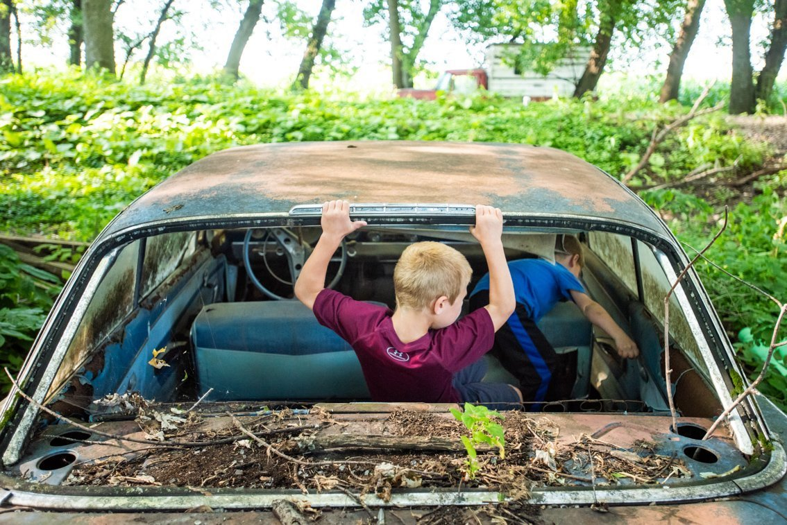 kids climbing in Chevrolet Impala