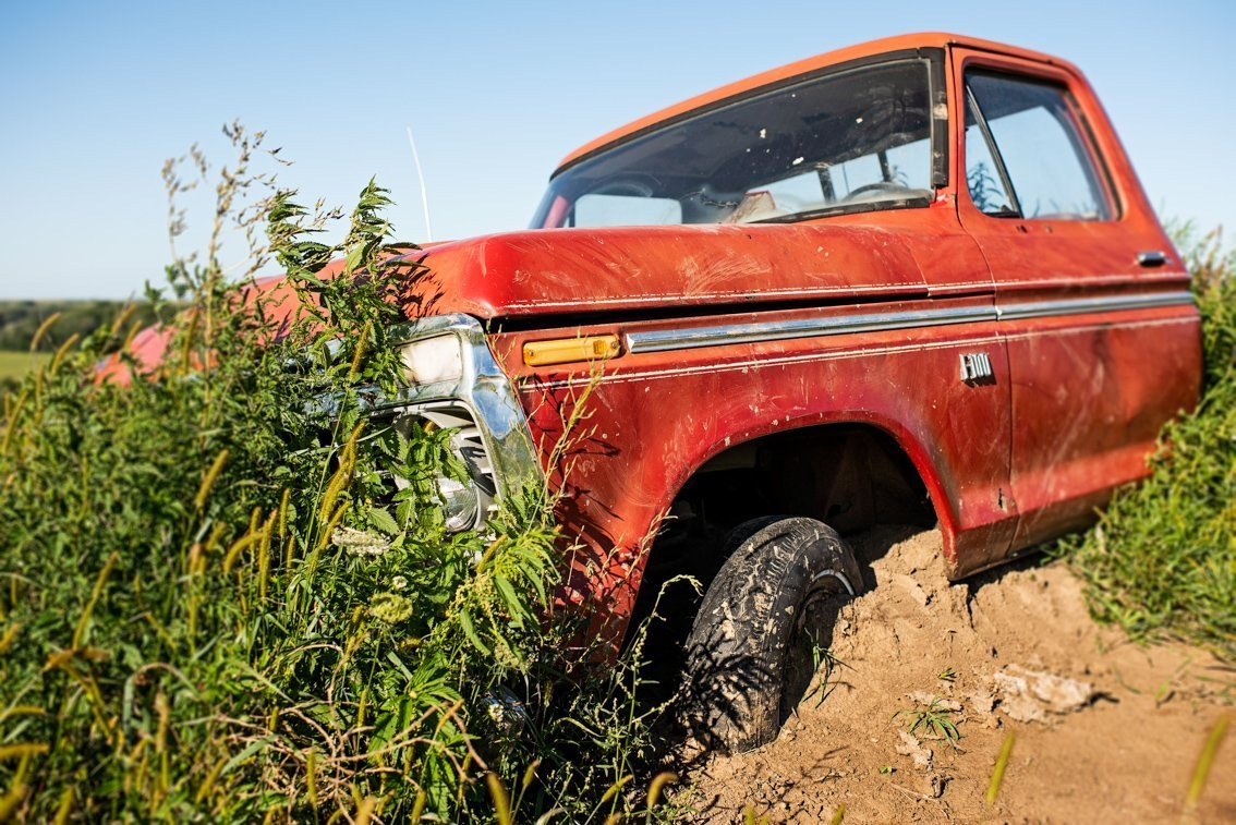 partially buried vintage Ford F100