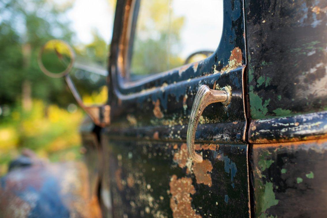 door handle of abandoned Chevy Pickup truck