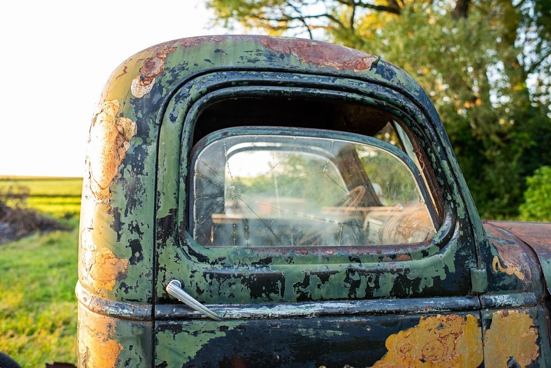side window of abandoned Chevy Pickup truck