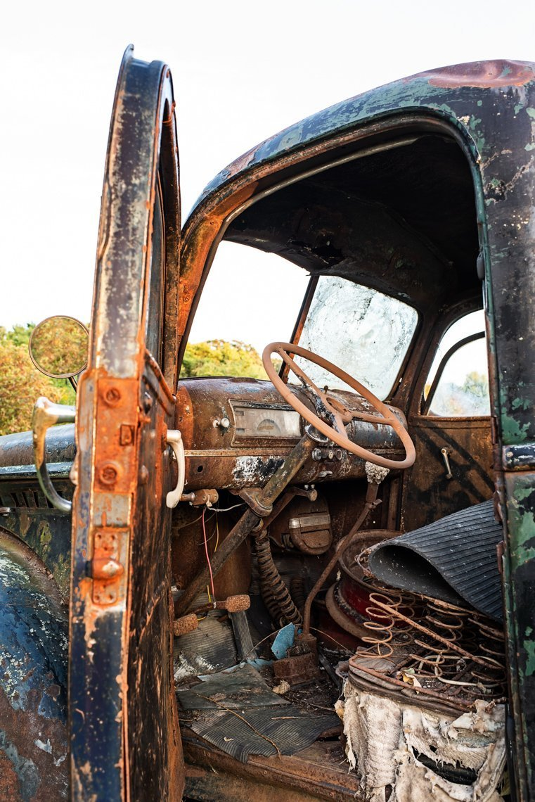 drivers side of abandoned Chevy Pickup truck