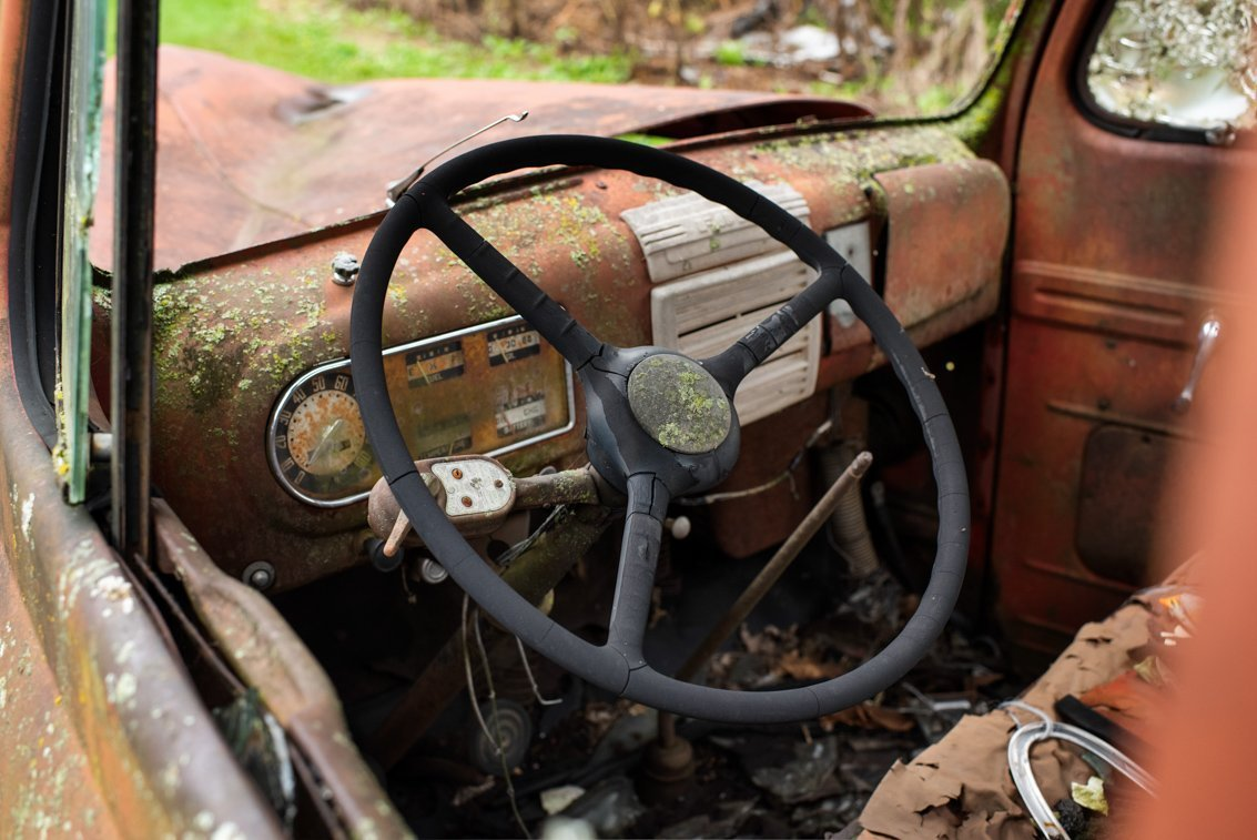 steering wheel of rusted Ford F1