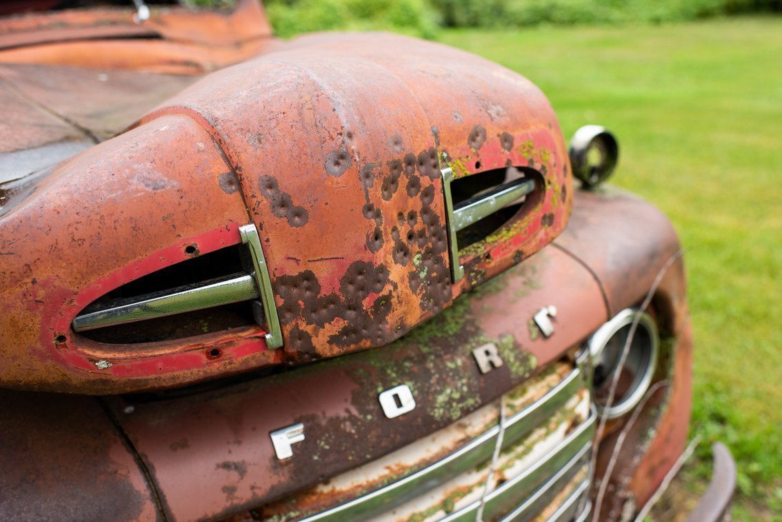 closeup of hood of rusted Ford F1