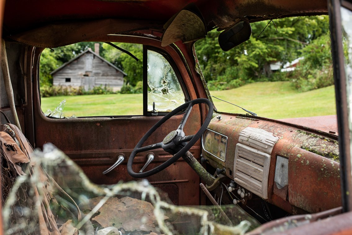passenger interior of rusted Ford F1