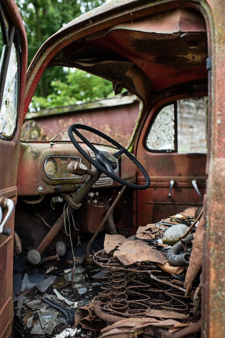 interior front of rusted Ford F1