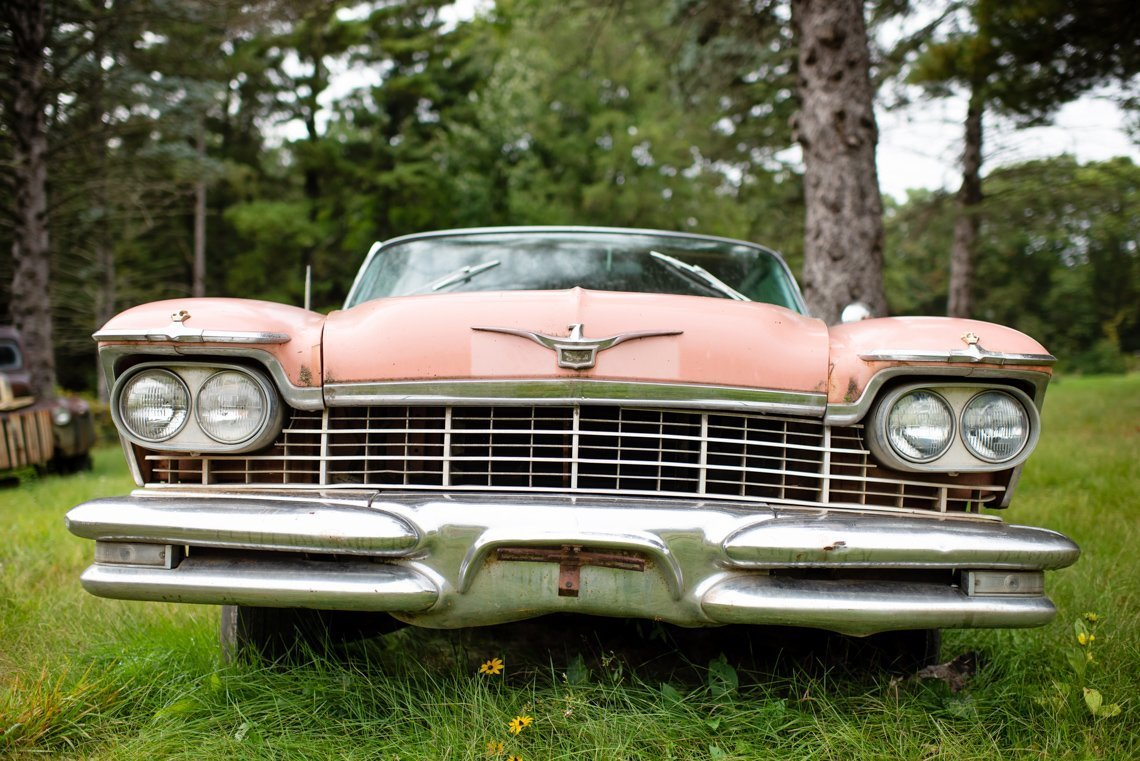 front of abandoned Chevrolet Imperial