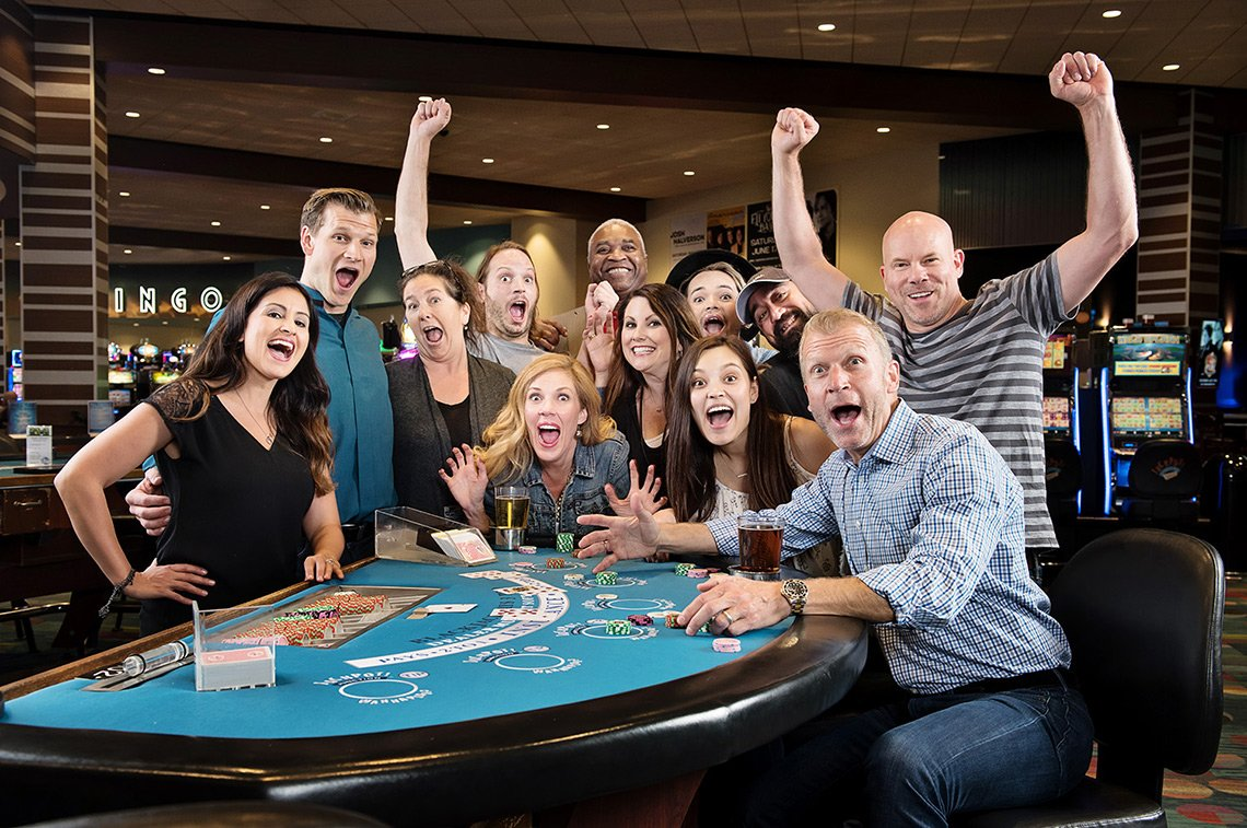 Dean and his crew of assistants, producers and models at a casino shoot in Minnesota.