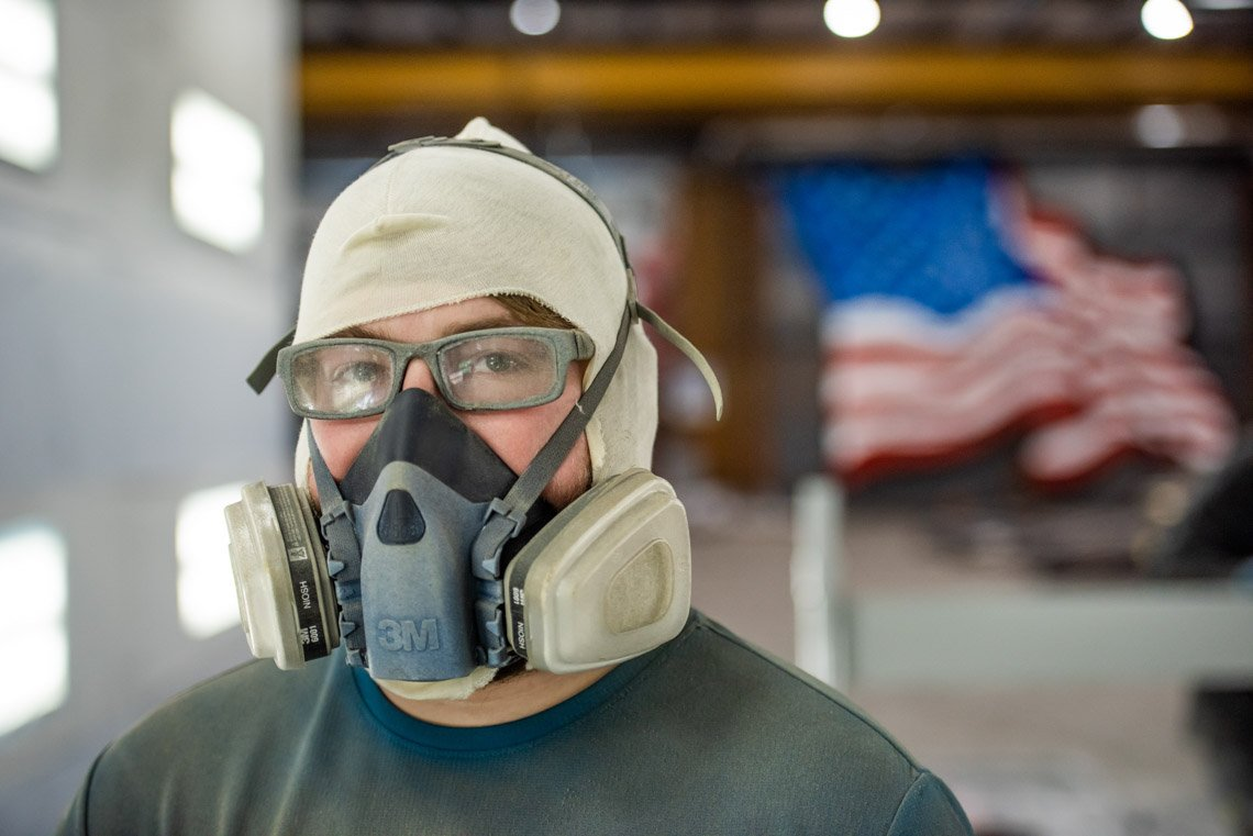 A worker wearing a spray mask at Central Sandblasting in Mpls